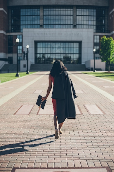A woman of color is on her way to university, a woman in STEM
